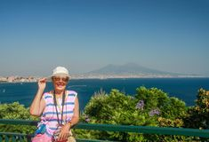 Happy mature tourist woman on the Naples bay background Royalty Free Stock Photo