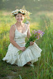 Happy mature woman. In camomile chaplet stock photos