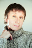 Happy mature woman. In the sweater Royalty Free Stock Photos