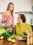 Happy mature woman with adult daughter cooking  together Stock Image