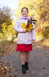 Happy mature woman  in autumn Royalty Free Stock Photo