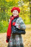 Happy mature woman in autumn Stock Image