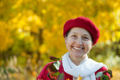 Happy mature woman  in autumn Stock Images
