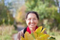 Happy mature woman  in autumn Stock Photo