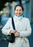 Happy mature woman in autumn street Royalty Free Stock Images