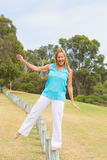 Happy Mature woman balancing outdoor Royalty Free Stock Photography
