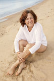 Happy mature woman on the beach Royalty Free Stock Images
