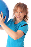 Happy mature woman in blue workout clothes feeling great Stock Photos