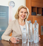 Happy mature woman with  bottles of water Stock Photography