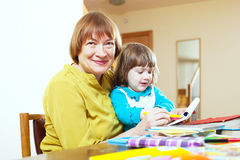 Happy mature woman and child Royalty Free Stock Images