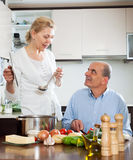 Happy mature woman and elderly senior cooking Stock Photography