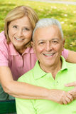 Happy Mature Woman Embracing Elderly Man Stock Images
