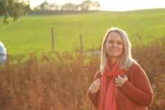 Happy mature woman enjoys leisure activities in evening sunlight Stock Photos
