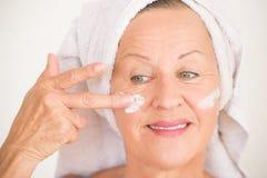 Happy Mature Woman face skin care Stock Photos