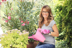 Happy mature woman in garden Royalty Free Stock Photos