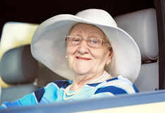 Happy mature woman in glasses driving auto Royalty Free Stock Photography