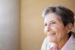 Portrait of a mature elderly woman smiling. Stock Photography