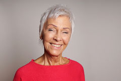 Happy mature woman in her sixties royalty free stock images
