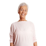 Happy mature woman in her sixties royalty free stock photography