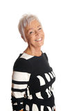 Happy mature woman in her sixties stock photography