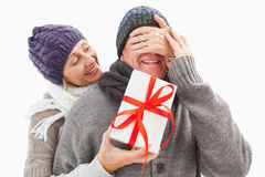 Happy mature woman hiding gift from partner Stock Photography