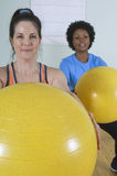 Happy Mature Woman Holding Exercise Ball Stock Images