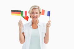 Happy mature woman holding flags Stock Photography