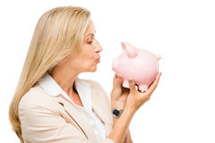 Happy Mature woman holding piggy bank isolated on white backgrou Stock Images