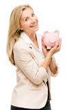 Happy Mature woman holding piggy bank isolated on white background stock images
