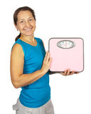 Happy mature woman holding scale Stock Images