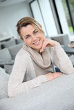 Happy mature woman at home Stock Image