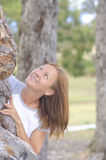 Happy mature woman hugging tree in park Stock Photos