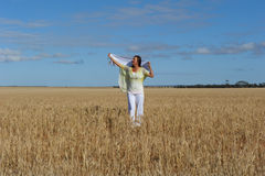Happy Mature Woman In Field Of Wheat Royalty Free Stock Photo