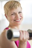 Happy Mature Woman Lifting Weights stock images