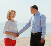 Happy mature woman with  man against sea Stock Image