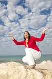 Happy mature woman ocean background Royalty Free Stock Image