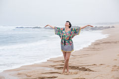 Happy mature woman with outspread arms Enjoying Vacation. Portrait of a Happy mature woman with outspread arms Enjoying freedom on the Ocean Beach. Freedom of Royalty Free Stock Image