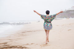 Happy mature woman with outspread arms Enjoying Vacation. Portrait of a Happy mature woman with outspread arms Enjoying freedom on the Ocean Beach. Freedom of Royalty Free Stock Photos