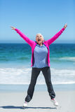 Happy mature woman outstretching her arms Stock Photo