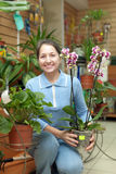 Happy mature woman with Phalaenopsis Stock Photos