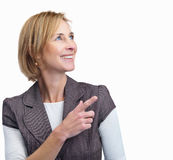 Happy mature woman pointing at copyspace Royalty Free Stock Photo