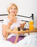 Happy mature woman  r breakfast Stock Photos