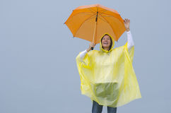 Happy mature woman in rain Royalty Free Stock Photography