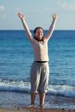 Happy mature woman on sandy beach Royalty Free Stock Image