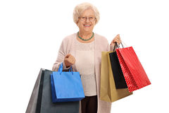 Happy mature woman with shopping bags. Isolated on white background Stock Photography
