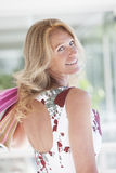 Happy mature woman with shopping bags. Happy mature woman smiling outdoors with shopping bags Stock Photography