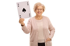 Happy mature woman showing an ace of spades card. Isolated on white background Stock Photos