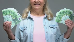 Happy mature woman showing euro banknotes, easy bank credit, pension wealth. Stock footage stock video footage