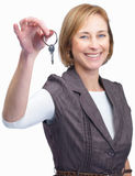 Happy mature woman showing  key to success Royalty Free Stock Images