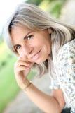 Happy mature woman smiling at camera Royalty Free Stock Photos